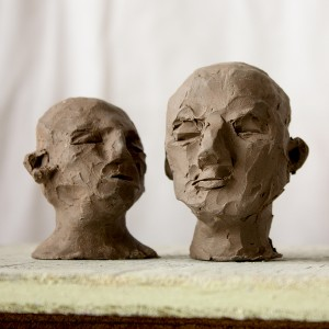 Two small heads sculpted in clay